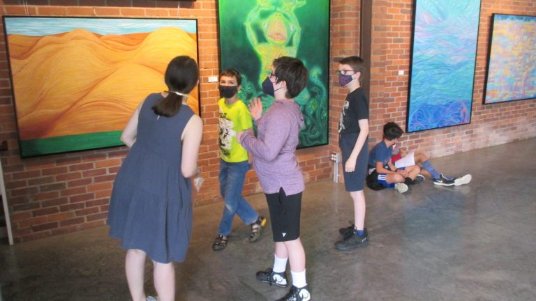 Category 5. 14.TPS students discuss paintings with their teacher, Abbey Kutlas-Pritchett
