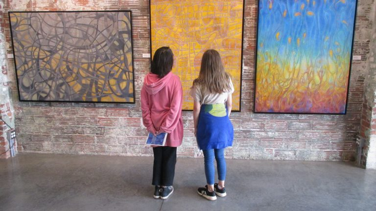 Category 5. 15. Two students from TPS discuss the paintings.2