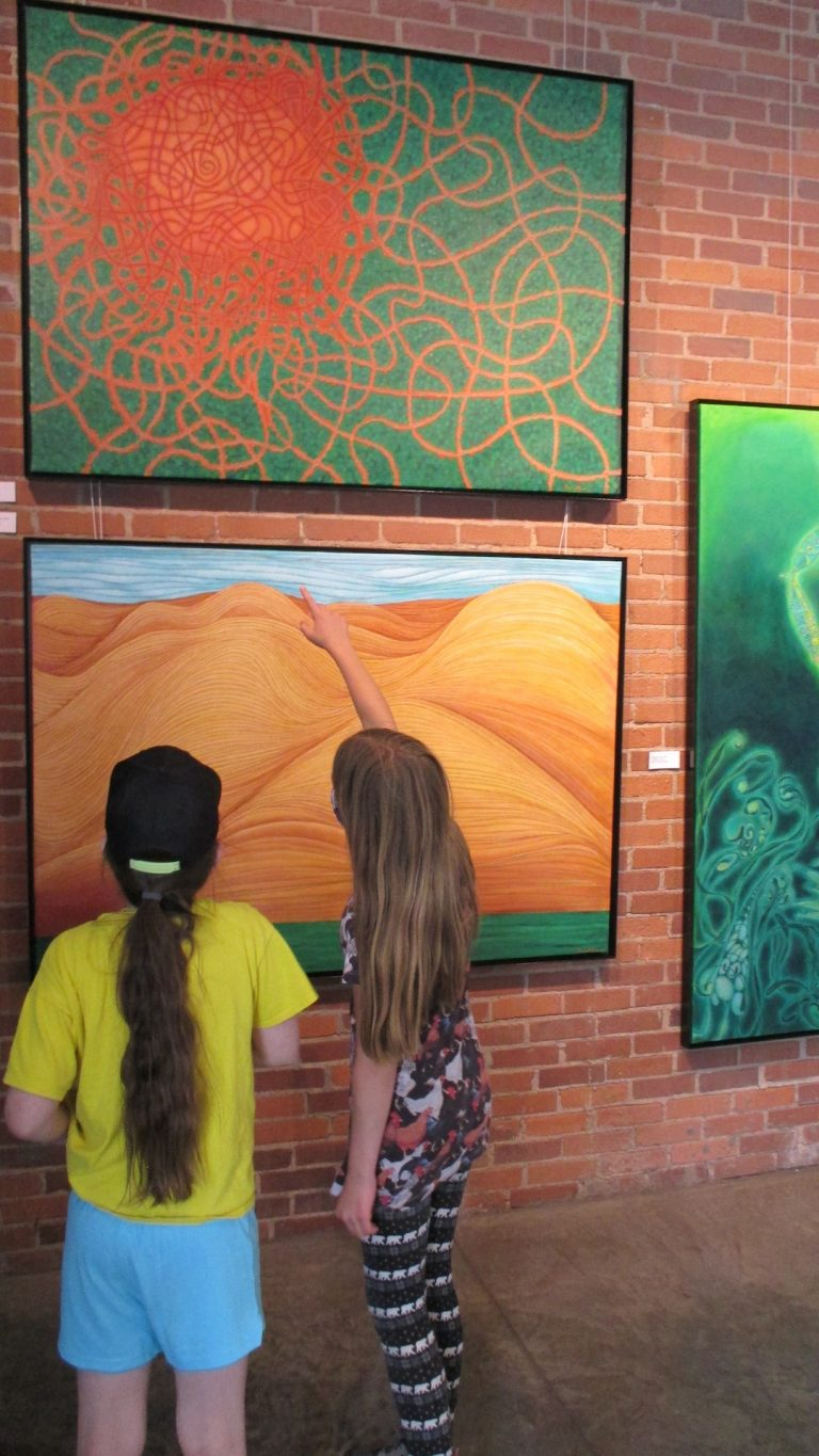 Category 5. 16. Two students from TPS discuss the paintings.3