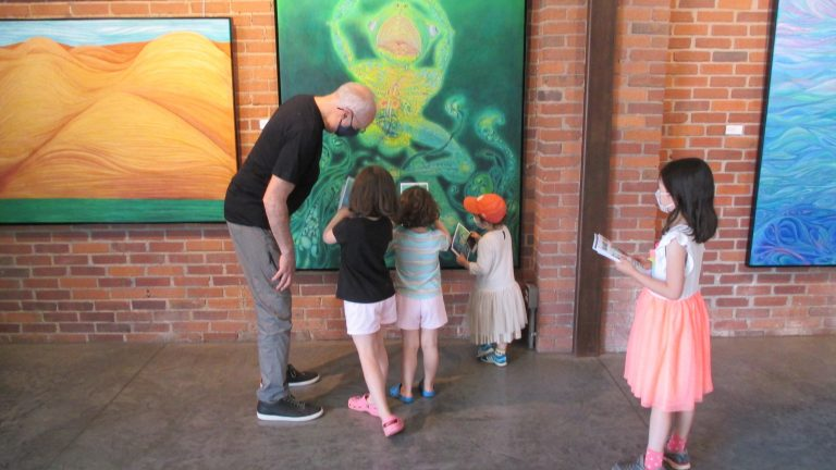 Category 5. 3. David engaging with children at the exhibition.1